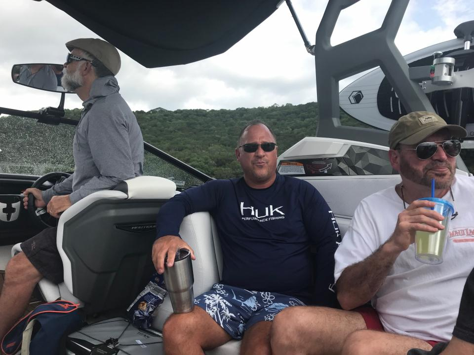 three men on a boat